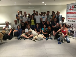 group photo of people and dogs that attended the class